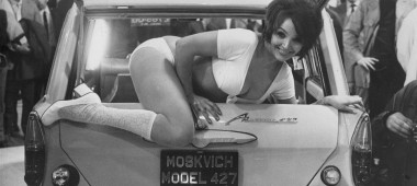 circa 1971:  Julie Desmond, a scantily clad, 24 year old model, climbs out of the back of a Russian Moskvich 427 car, at a car trade show.  (Photo by Evening Standard/Getty Images)